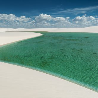 White sand dunes and colorful lagoons formed during the rainy season.